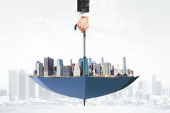 Cityscape upside down umbrella concept Stock Photo