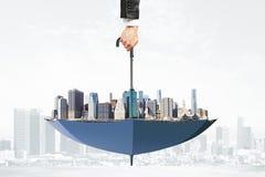 Cityscape upside down umbrella concept Stock Photo