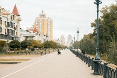 Cityscape. Urban road in a typical street of modern buildings in big city. Bird and green trees in residential district. Pedestrian zone. Kyiv. Ukraine Royalty Free Stock Image