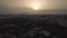 Cityscape of Valencia with houses and park, aerial view. Aerial view of Valencia with houses and green park at sunset, Spain stock video footage