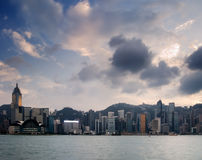 Cityscape of Victoria harbor with white cloud and Stock Photos