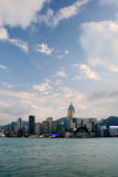 Cityscape of Victoria harbor with white cloud Royalty Free Stock Image