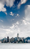 Cityscape of Victoria harbor with white cloud Stock Images