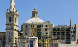 Basilica of Our Lady on Malta. Cityscape view with Basilica of Our Lady of Mount Carmel on the island of Malta. Buildings with traditional colorful maltese Stock Photo