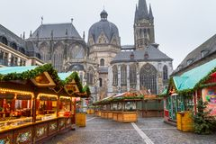 Cityscape - view of the Christmas Market on the background the Aachen Cathedral. North Rhine-Westphalia, Germany royalty free stock image