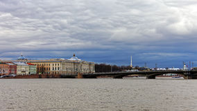Cityscape view of embankment in Saint-Petersburg, Russia. Dramatic cityscape in sunset Stock Images