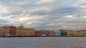 Cityscape view of embankment in Saint-Petersburg, Russia. Imperial Academy of Arts. Dramatic cityscape in sunset Royalty Free Stock Photos