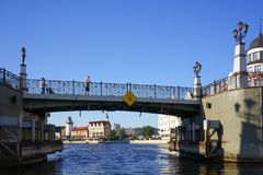 Cityscape with view of the historic bridge and walking people. Kaliningrad, Russia - May 11, 2016: Cityscape with view of the historic bridge and walking people Stock Image