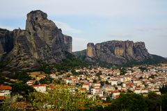 Cityscape view of Kalambaka ancient town with beautiful rock formation mountain, immense natural boulders pillars and sky. Background, Greece Stock Photos