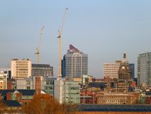 Cityscape view of leeds showing the modern buildings city hall and construction cranes. A cityscape view of leeds showing the modern buildings city hall and royalty free stock photography
