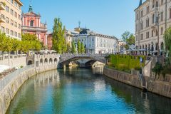 Cityscape view on Ljubljanica river canal in Ljubljana old town. Ljubljana is the capital of Slovenia and famous european tourist destination Royalty Free Stock Photo