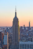 Cityscape view of Manhattan with Empire State Building at sunset Stock Image