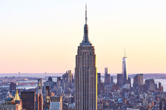Cityscape view of Manhattan with Empire State Building at sunset Stock Images