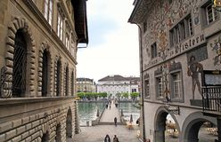 Cityscape with view of medieval houses with murals and bridge o. LUCERNE, SWITZERLAND - MAY 6, 2013: Cityscape of Lucerne with view of medieval houses with stock images