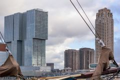 Cityscape - view of the skyscrapers of district Feijenoord through the rigging of the moored sailboat, Rotterdam. Netherlands Stock Photo