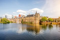 Haag city in Netherland. Cityscape view on the small lake with beautiful old buildings and modern skyscrapers on the background in the centre of Haag city Royalty Free Stock Photo