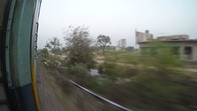Cityscape view during a train ride in Mumbai. stock footage