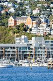 Cityscape view from Wellington waterfront looking towards Saint Gerard`s Monastery located on the hill behind Clyde Quay Mariner. Wellington, New Zealand - June royalty free stock images