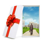 Cityscape with walking businessman in gift box Royalty Free Stock Photo