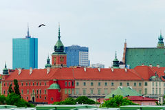 Cityscape of Warsaw with the historic Royal Castle and modern office buildings. Poland. Stock Photography
