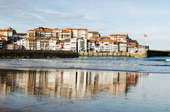 Cityscape water reflection. Charming village on biscayan coast, spain Royalty Free Stock Images