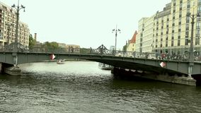 Cityscape and Weidendammer Bridge on Spree river in Berlin city, Weidendammer Brcke, tourist ships on the river Spree.  stock video