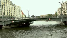 Cityscape and Weidendammer Bridge on Spree river in Berlin city, Weidendammer Brcke, tourist ships on the river Spree.  stock video footage