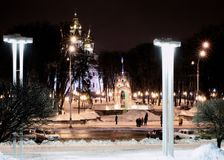Cityscape winter night. Illuminated by streetlights Stock Images