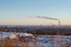 Cityscape in winter. Urban landscape with dry herbs, snowdrifts, and houses on the background stock images