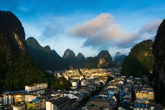 Cityscape of Yangshuo in China and famous karst formations Royalty Free Stock Images
