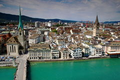 Cityscape Zurich, Fraumunster and St. Peter Church, Switzerland. Wide angle cityscape of Zurich city center: river Limmat, old town rooftops, Fraumunster and St Royalty Free Stock Photography