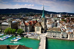 Cityscape Zurich old town with Fraumunster Church, Switzerland. Cityscape of Zurich old town: the reformed Fraumunster Church, Munsterbrucke bridge on the river Royalty Free Stock Images