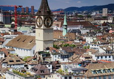 Cityscape Zurich old town with St. Peter Church, Switzerland. Cityscape of Zurich city center: old town rooftops and the reformed St. Peter Church with the Royalty Free Stock Photo