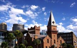 Cityscapebakgrund av den Sydney staden, Australien med blå himmel och arkivfoton