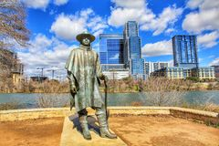 Cityscapes. Skyline view of the downtown district along the Colorado River with the statue of the late Stevie Ray Vaughan cityscapes stock images