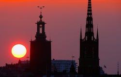 cityscapestockholm solnedgång royaltyfria foton