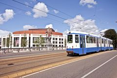 Cityview in Amsterdam the Netherlands. The Stopera and a running tram at the Blauwbrug Royalty Free Stock Photo