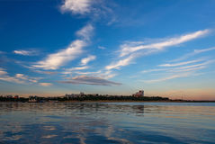 Cityview with clouds and river. Cityview of Irkutsk with blue evening sky and clouds and their reflection in water Royalty Free Stock Photography