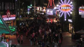 Citywalk Orlando. Orlando, USA - February 12, 2016: Crowds of tourists and locals gather at Citywalk in Orlando, major destination stock video