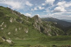 Ciucas Mountains. Hiking trail and strange rock formations in Ciucas Mountains Stock Image