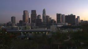Ciudad céntrica de Los Ángeles en la puesta del sol - lapso de tiempo almacen de metraje de vídeo