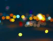 Ciudad colorida Bokeh en fondo muy oscuro de A Imagen de archivo