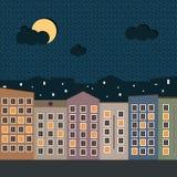 Ciudad colorida en la noche Foto de archivo libre de regalías
