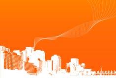 Ciudad con el fondo anaranjado. Foto de archivo