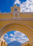 Ciudad de Guatemala, Guatemala, April, 25, 2018: The famous arch of the city center of Antigua together with agua. Volcano in the horizont, view through the Stock Images