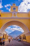 Ciudad de Guatemala, Guatemala, April, 25, 2018: The famous arch of the city center of Antigua together with agua. Volcano in the horizont, view through the royalty free stock photos
