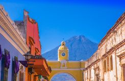 Ciudad de Guatemala, Guatemala, April, 25, 2018: Outdoor view of old street with clasical buildings in the city of. Antigua with colorful yellow arch with the Royalty Free Stock Photos