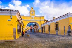 Ciudad de Guatemala, Guatemala, April, 25, 2018: Outdoor view of Santa Catalina arch and the main street of Antigua city. At sunny day in Guatemala Royalty Free Stock Photography
