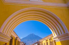 Ciudad de Guatemala, Guatemala, April, 25, 2018: Unidentified people walking in the streets of antigua city and view of. Active Agua volcano in the background Royalty Free Stock Photography