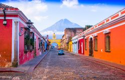 Ciudad de Guatemala, Guatemala, April, 25, 2018: Cityscape in the main street of Antigua city with the Agua volcano in. The background, Guatemala Royalty Free Stock Image